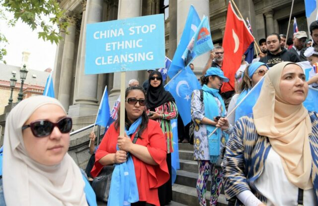 Members of the Uyghur community protest in front of Parliament House in Adelaide in 2018